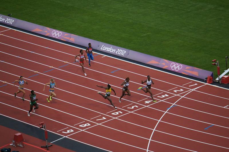 Llegada carrera 100 m. mujeres en Juegos Olímpicos de Londres 2012. © cdephotos